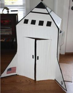 Space Shuttle out of Cardboard Box. Def wanna do a space unit for C. Cardboard Rocket, Cardboard Crafts, Cardboard Boxes, Cardboard Spaceship, Cardboard Playhouse, Diy For Kids, Crafts For Kids, Outer Space Theme, Space Party