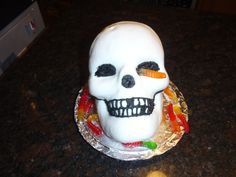 Halloween - 3d skull cake pan and marshmallow fondant (and the occasional gummy worm!)