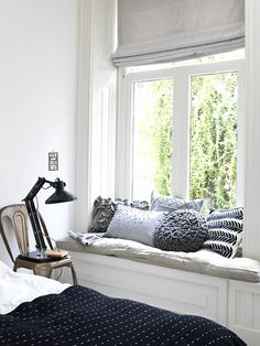 comfy and luminous window nook (via Kim Timmerman) - my ideal home...