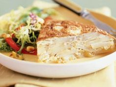 Spanish Tortilla | A Spanish tortilla is an omelet filled with potatoes and onions and served as a main dish.