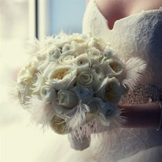 Bouquets with feathers. http://www.weddingthingz.com/1/post/2013/03/using-feathers-in-a-wedding.html