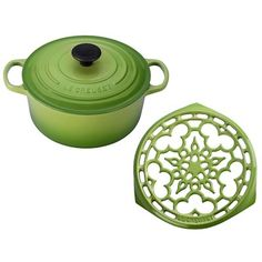 Create a gourmet vegetable soup or experiment with baking a loaf of bread with this Dutch oven and trivet set from Le Creuset. This round Dutch oven, also known as a French oven, is a versatile piece of cookware made from enameled cast iron. Cast individually in sand molds, then hand-inspected by French artisans, each
