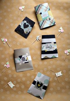 Looking for an easy gift box?  This tutorial shows you step-by-step for creating these adorable gift boxes!  The gift boxes are perfect goodie bags for a party or seal the top to turn them into a decorative way to give a gift card to a grad!