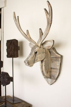 The Recycled Wooden Deer Head Wall Hangingwill give an eye-catching look