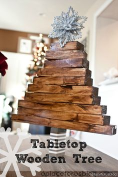 A Christmas Craft... Table top wooden tree! Love this. My kids have been fascinated by similar ones at Target that spin. We call them Jenga trees :)