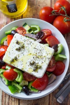 """Classic Greek Salad (Horiatiki) - made the REAL Greek way _ It turns out that I've been making Greek Salad wrong my entire life. I had a chance to take a cooking class while we were in Athens, so I learned the """"proper"""" way to make this delicious & popular dish!"""