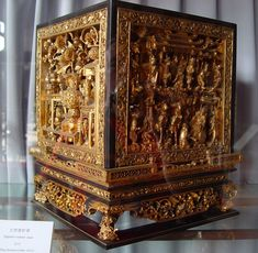 Gold-gilded, carved wood box.