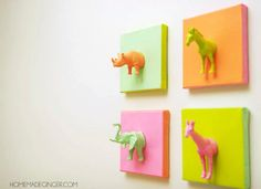 This cute DIY canvas art made with plastic animals is such a fun and easy idea! It's perfect for a nursery, kids' room, or craft studio.