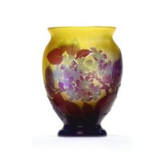 A Gallé cameo glass vase circa 1910 colourless glass with a yellow layer, overlaid in blue and red, etched with blossom branches cameo mark Gallé height 15 cm