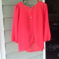 Red blouse with gold buttons details on the back The gold button details on the back are what makes this shirt 👌🏻 Blue Rain Tops Blouses