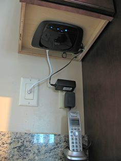 best cable box mounting hide your router under a kitchen cabinet cox cable box installation Cable Box Wall Mount, Hide Cable Box, Hide Cables, Hide Wires, Vinyl Record Storage, Lp Storage, Hidden Storage, Modern Cottage Decor, Hide Router
