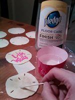 If you ever want to write on sand dollars, here's what you do:   Two coats of Pledge Floor Care Finish (with Future Shine) -- apply with a cotton swab -- wait at least 20 minutes to dry and use a Sharpie paint pen to write. The protective wax coating (a) makes it easier to write (no longer a chalky surface), (b) saves the paint pen from drying up faster and (c) prevents the paint pen from bleeding (as it would on the original porous surface).