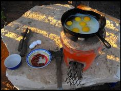 DIY rocket stove: Lots of good pictures showing how to build a rocket stove out of adobe or cob aka dirt and mud like a southwest type of construction. Good stuff here!