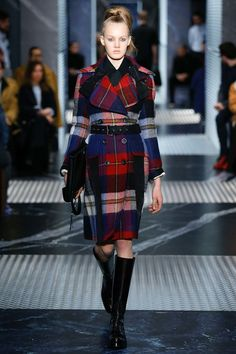 The perfect coat for traveling on state occasions. - Photo: Courtesy of Prada