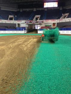 Spreading the green shavings before the World's Championship Horse Show begins tonight in Louisville ... wish I was there!!!