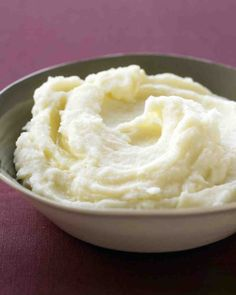 Garlic Mashed Potatoes Recipe - add cream cheese and sour cream. place in 13x9 pan and dot with butter and sprinkle with paprika. heat through after turkey is out of oven.