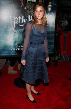 Emma Watson Ballet Flats -   Emma donned black pointy toed flats with her tiered blue cocktail dress at the 'Harry Potter' premiere.