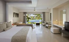 Check out our Junior Suite Pool View Swim-Up King room at Secrets Silversands Riviera Cancun
