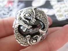 Massive Silver Koi Carp Ring, handcrafted from sterling silver and available at https://takumiarts.com Fine Japanese Jewelry from myths and legends : Dragon, Phoenix, Maneki Neko, Koi Carp, Sakura flowers, Youkai and much more. Handcrafted from sterling silver, pure silver and 18k gold. Free shipping and worry-free returns.