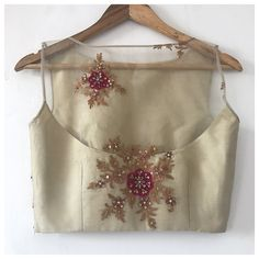 This delicate blouse is in pure organza with hand embroidery using silk threads and beads. The back is sheer.
