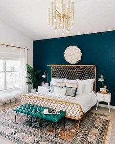 Mix Moody with Metallics à la @avestyles Let your pieces live up to their potential. Here, a teal accent wall provides a foundation that gives modern light fixtures and architectural furnishings alike their due—they pop against the rich hue