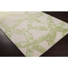 Fabulous hand-tufted 100% New Zealand wool area rug with light lettuce green starfish on a white background. #sale #coastalrug