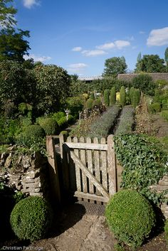 Barnsely House Potager. The semi-formal interior of a French Garden, and rustic wall of an English Garden.