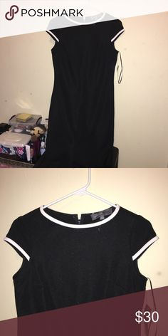 Donna Ricco chic minimalist midi dress Gorgeous midi length bodycon dress. Thick fabric so looks very elegant. Never worn. Purchased for $70 at department store. Not Calvin used tag for exposure on dress as it isn't a well known brand Calvin Klein Dresses Midi