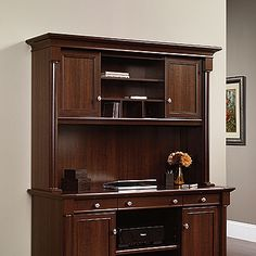 Attaches to  Credenza 412079  or  L-Shaped Desk 413670 .  Adjustable shelf behind each door.  Open storage with cubbies features adjustable shelf.  Cord management.  Select Cherry finish.
