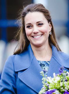The Duchess of Cambridge wears Max Mara for a day of Royal Engagements.  The senior royal is due in early April with her second child.