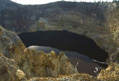 This black lake is located in a volcano crater in Flores, Indonesia. Its water fills the old cone of the still-active Kelimutu volcano, and the lake gets its mysterious, onyx appearance from volcanic ash particles that seep into the water from below.