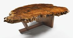 Mira Nakashima MONUMENTAL DINING TABLE, redwood root burl top with extraordinary free-form edge, dramatic fissures and East Indian rosewood butterflies withAmerican black walnut base, 29 x 100 x 73 in. 2008