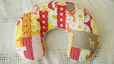 quilted boppy pillow cover with pocket. Fantastic handmade accessory for a must-have item, a great personal gift for new moms. From For The Love Of Joy etsy. #boppy #handmade