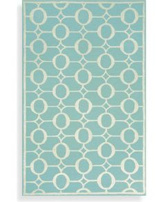 Aqua area rug for the kitchen sink area.