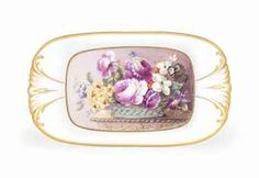 A NANTGARW SHAPED-OVAL DISH  CIRCA 1821-23  With gilt shell-moulded handles, painted by Thomas Pardoe, with luxuriant pink roses and other garden flowers issuing from a basket on a table, within gilt line cartouche   10 7/8 in. (27.7 cm.) wide