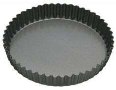 """10"""" Round Fluted Quiche Pan / Tin - Loose Based - Non Stick by KitchenCraft. $17.49. Dishwasher, oven, fridge and freezer safe.. Size: 25cm (10""""). Five year non-stick guarantee.. Twenty year guarantee.. Round 10"""" Fluted Flan Tin  This loose base fluted tin is suitable for flans, tarts and quiches.  The Master Class range of award winning bakeware is of a robust commercial weight, and has a high quality, double layered non-stick coating.  This range has a 20 year guar..."""