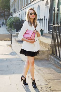 Favourite white blazer paired with black pleated shorts and black modern design heels, finished with aviator sunglasses and a pop of pink colour in the bag. Super cute!