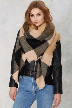 The super soft All or Nothing Scarf features camel and black plaid with raw edges and an oversized fit.
