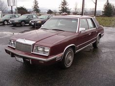 1987 Chrysler New Yorker.  Black.  My first car with electric controls.  LOL!