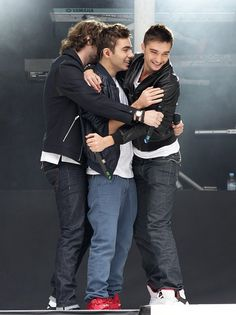 The Wanted enjoy a reunion hug onstage at Wembley stadium. | The Wanted At The Summertime Ball 2013 - Pictures - Capital FM
