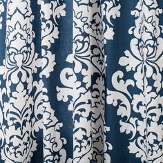 Made from 100% cotton slub cloth, this traditional window panel features a damask vertical design in navy and white.