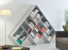 not usually a fan of 'weird' bookcases, but this one is pretty neat