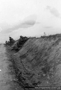 Southern Russia, summer 1941. SS men dismounted to counter a threat from the road side.  A sequences of photos.