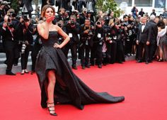"British pop star Cheryl Cole certainly won over the photographers on the red carpet as she blew kisses their way while flashing her pins in a black gown at the ""Foxcatcher"" premiere at Cannes Film Festival on May 19, 2014."