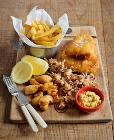 Battered & combo with golden Perfect for sea, sun and beach holidays! Calamari, Beach Holiday, Burgundy, Chips, Restaurant, Sea, Holidays, Food, Holidays Events