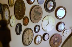 OMG! I thought I had an original idea with my living room clock wall...now I just need to find some vintage clocks!