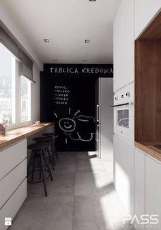 projekt 10 - Średnia zamknięta kuchnia dwurzędowa w aneksie z oknem, styl nowoczesny - zdjęcie od PASS architekci