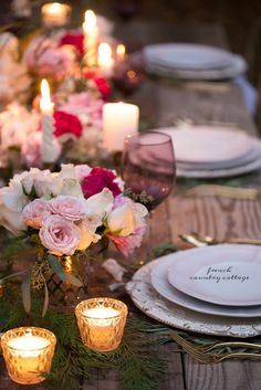 A romantic holiday party table setting  -  I am all about romantic details over here.   They might be as simple as a bouquet on a small table ...