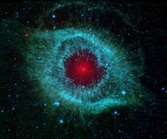 Infrared radiation from the well-studied Helix Nebula (NGC 7293) a mere 700 light-years away in the constellation Aquarius. The two light-year diameter shroud of dust and gas around a central white dwarf has long been considered an excellent example of a planetary nebula, representing the final stages in the evolution of a sun-like star. But the Spitzer data show the nebula's central star itself is immersed in a bright infrared glow. Models suggest the glow is produced by a dust debris disk.