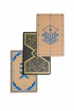Brown and blue and black and gold notebook sets with a cute pattern on the front from Avalanche Print.